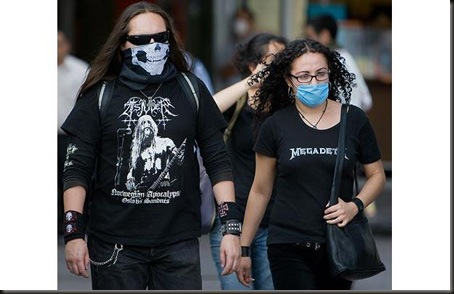 A couple wearing face masks to prevent contagion of the swine flu walk in Mexico City on April 28, 2009. Mexico is the epicenter of a deadly swine flu outbreak, which has been blamed for more than 150 deaths nationwide, while the number of cases under observation has reached 1,614. The UN World Health Organisation (WHO) said it was still not inevitable however even though it has raised its alert to an unprecendented level four. Airlines and tour operators suspended flights to Mexico as new cases were confirmed across the globe and officials warned of more fatalities.  AFP PHOTO/Omar Torres (Photo credit should read OMAR TORRES/AFP/Getty Images)
